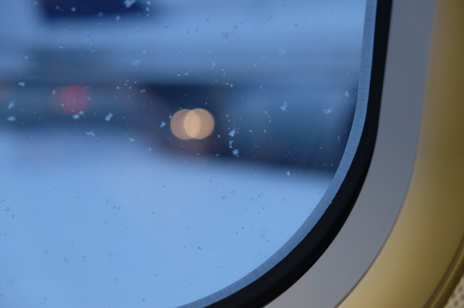Snowflake on airplane window
