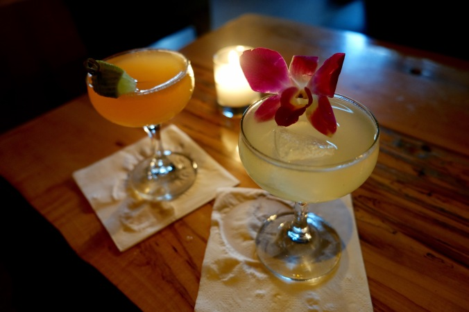 A tropical cocktail garnished with an orchid