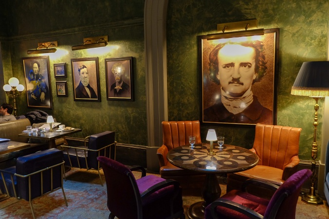 Portrait of Edgar Allan Poe above a table