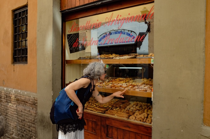 Looking through the window at traditional Italian cookies at the Biscotteria Innocenti in Trastevere Rome