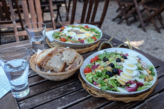 Fresh salads at an outdoor table in the countryside outside of Rome