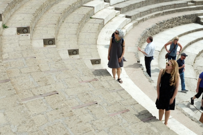 Standing on stairs in an amphitheater in Pompeii