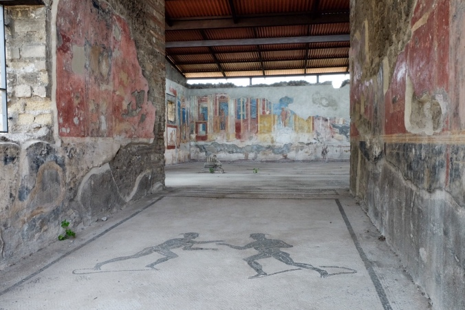Beautiful faded murals in an ancient home in Pompeii