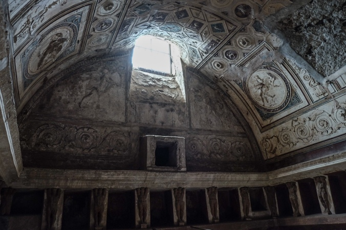 The intricate rounded ceiling of a bathhouse in Pompeii