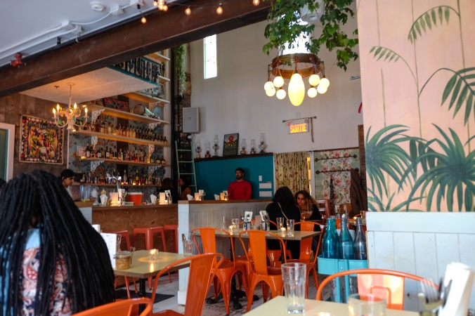 Lively interior of Haitian restaurant Agrikol