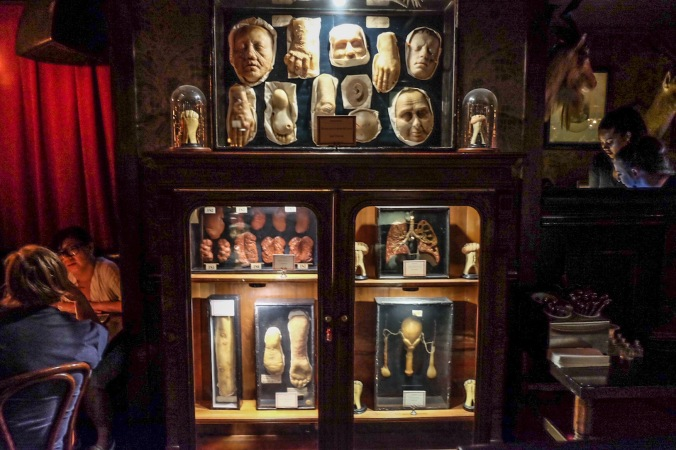 A cabinet inside the House of Wax filled with morbid wax models